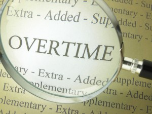 Overtime in Dictionary with Magnifying Lens
